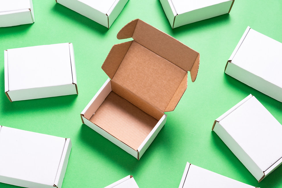 Lot of square carton boxes on green back
