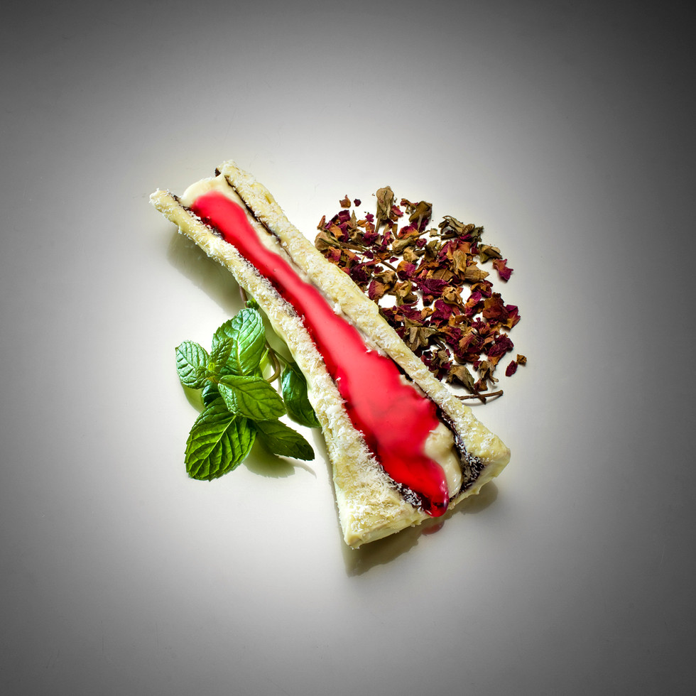 Dessert; Muhallebi - served in a veal bone covered by white chocolate and coconut crumbs. White chocolate, cacao chocolate , rose water, coconut, mint, Melby (cream)