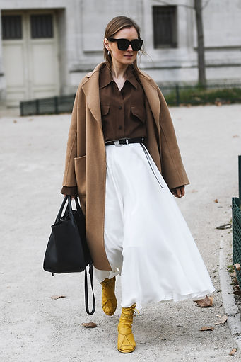 WOman with Camel Trench, white skirt, ye