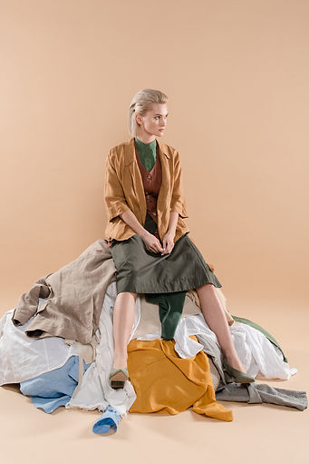 Woman sitting on stack of clothes.jpg