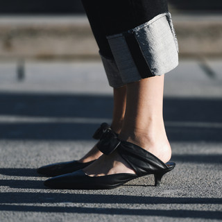 Black shoes - slides with cuffed jeans.j
