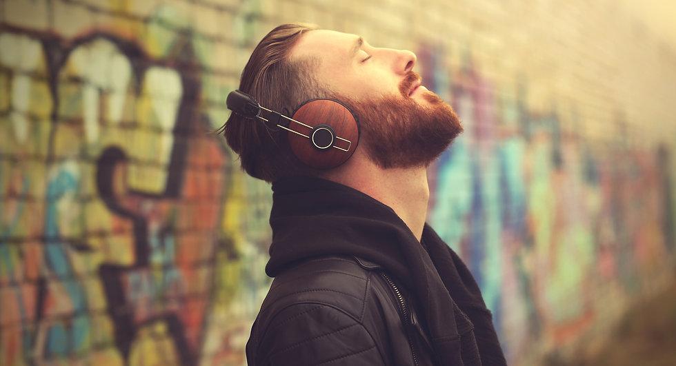 Handsome%20man%20in%20headphones%20listening%20to%20music%20outdoors_edited.jpg