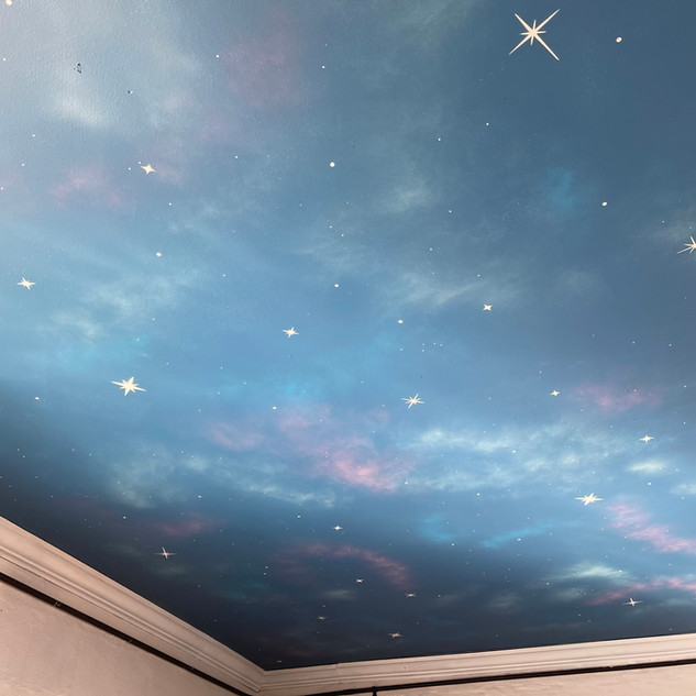 Sky Bear Confections ceiling mural.
