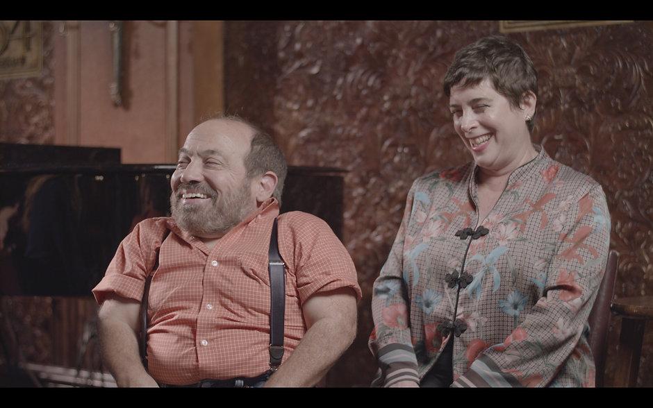 Danny Woodburn and Amy Buchwaldlaughing