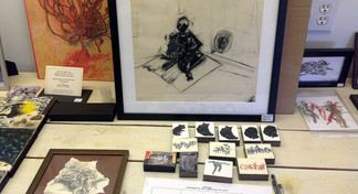 Showing space bench with drawings & small prints