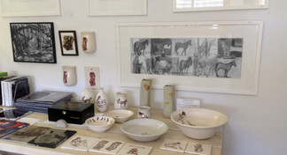 Showing space bench w. pottery & drawings