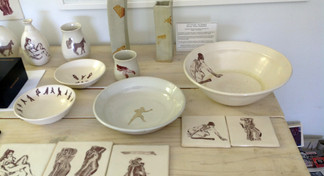 Showing space bench w. pottery