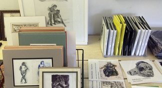Showing space bench w. artist's books & small prints