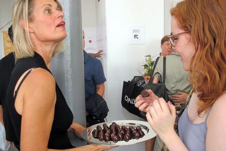 Julienne Tullemans serving chocolates