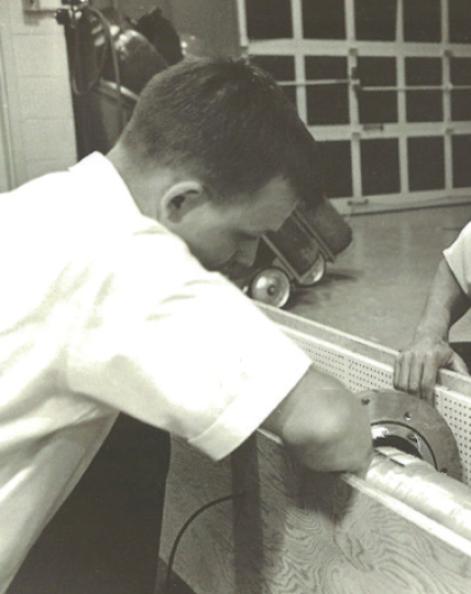 Picture of Darrell Gretz working with a cryogenic application ~1968