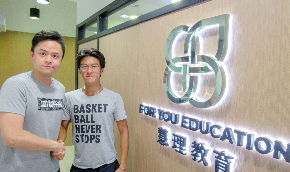 IB High scorer Brian Ma, with his tutor Johnny Ma at the For You Education Centre.