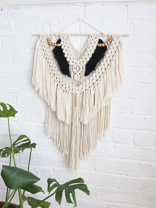 white black and gold macrame wall hanging with beads