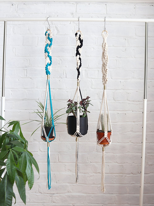 blue black and white macrame plant hangers with gold