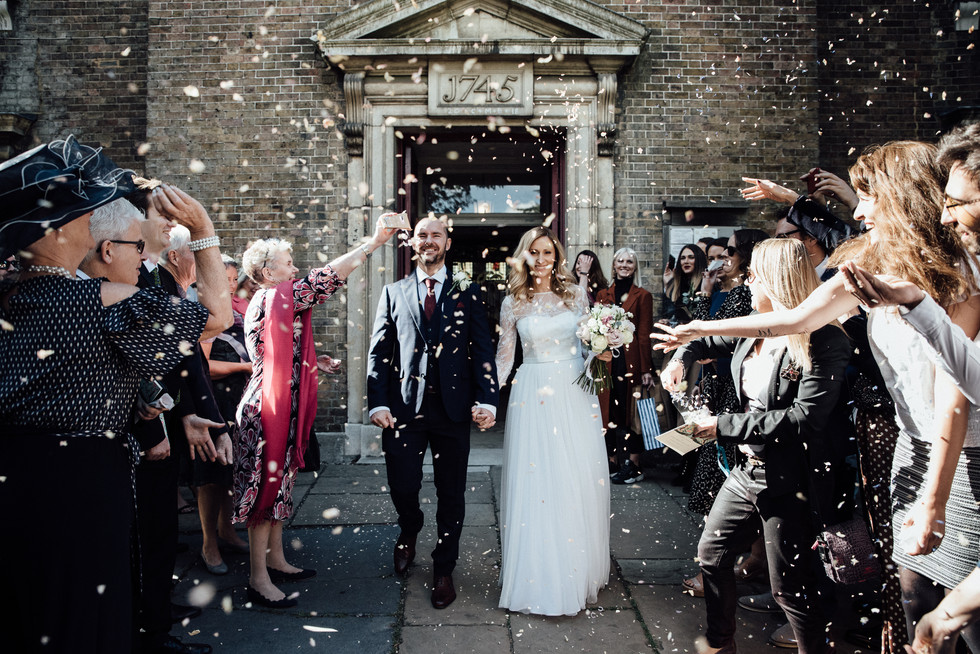 Throwing confetti in Hamstead Heath- Wedding photography by Joe Twigg