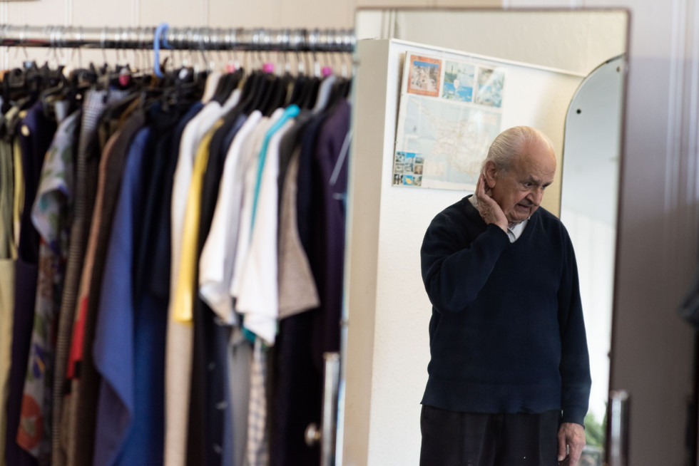 Michael in his shop - Michael's Fashions.