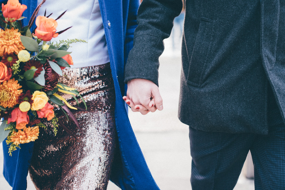 Couple holding hands after ceremony