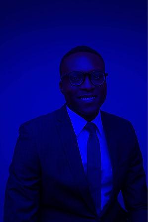 Blue Black African Nigerian Man in English Atire