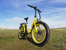 misterride ebike gelb wiese tourbike.jpg