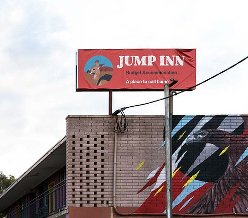 Jump Inn rooftop signage and street art image of wedge tailed eagle