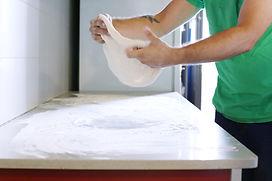 A man kneeding dough