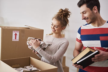 happy-couple-packing-their-stuff-into-bo