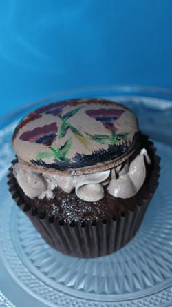 Hand painted macaron on cupcake
