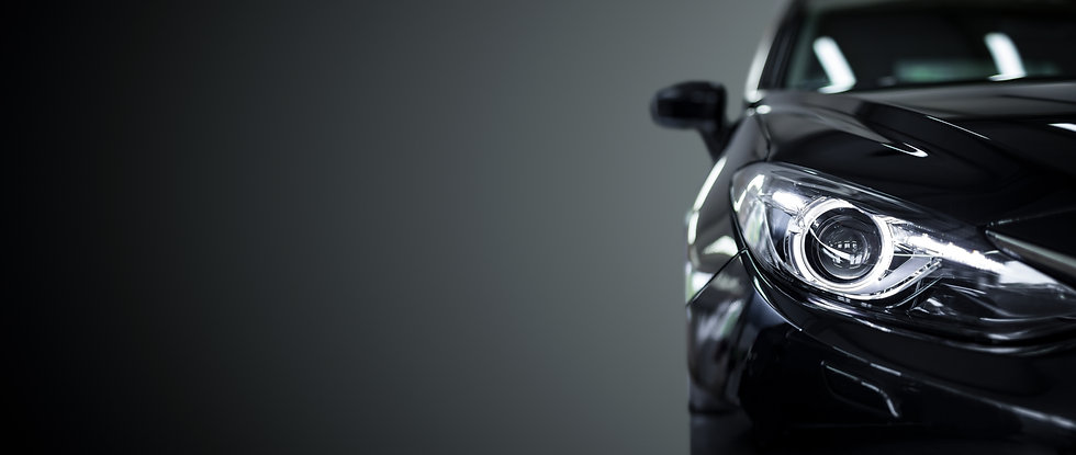 Black modern car closeup on black backgr