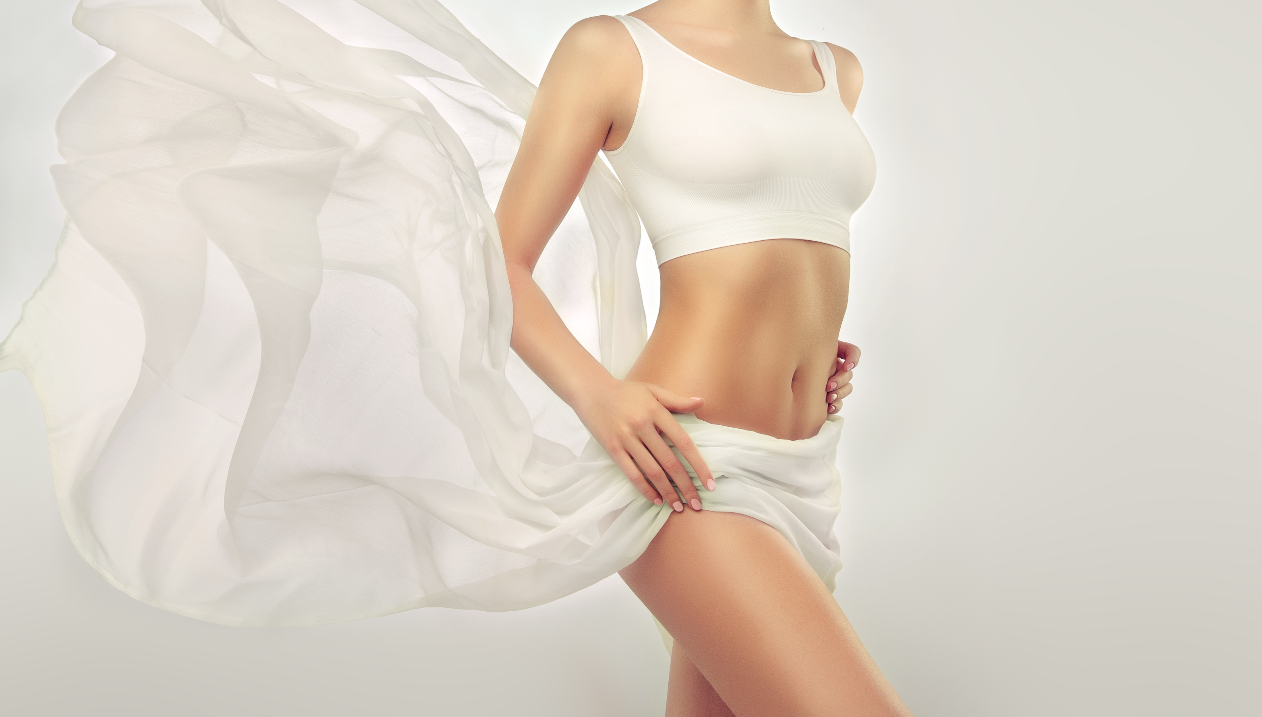 Perfect slim toned young body of the girl .jpg An example of sports , fitness or plastic surgery and