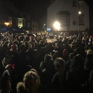 The Christmas lights switch on!