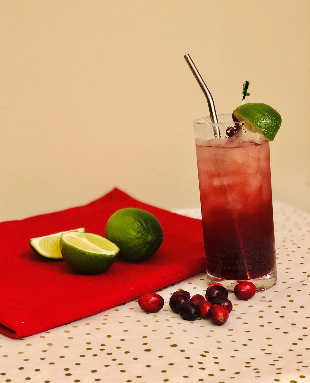 Cranberry margarita, limes and cranberries, highball glass, Christmas margarita