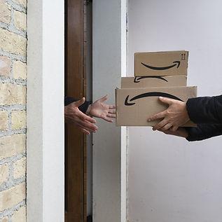 handing person Amazon package.jpeg