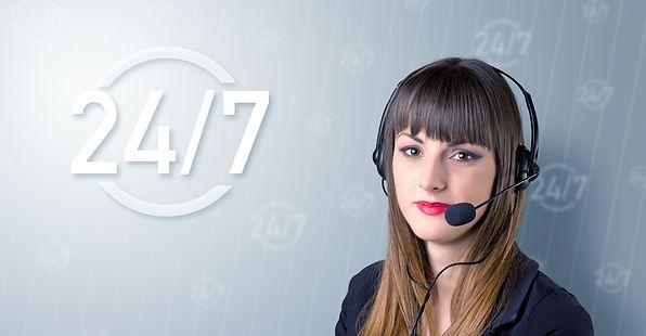 Female call center representative ready 24/7.