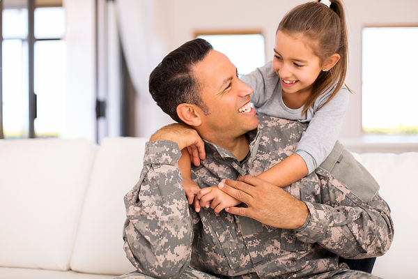 Military man smiling with daughter