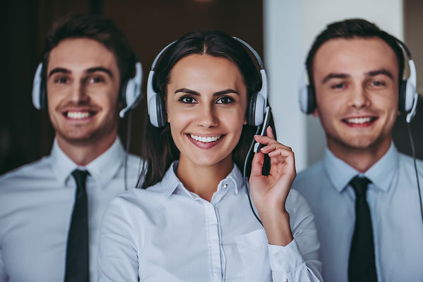 3 call center employees smiling with headsets on