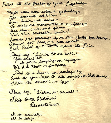 Photograph: lyrics for Ballad to the Backs of Your Eyelids, scrawled over a faded photo of a stained, lace curtain.