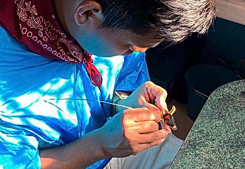 Artisan makes gold Mayarca bull head necklace
