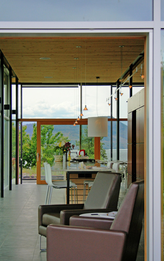 View through the kitchen of the Glass House to the orchard landscape of the Naramata Bench.  image courtesy of Allen + Maurer Architects