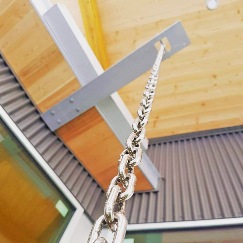 Custom rain scupper detail showing the fir soffit material harvested from the property.  image courtesy of McDiarmid Construction