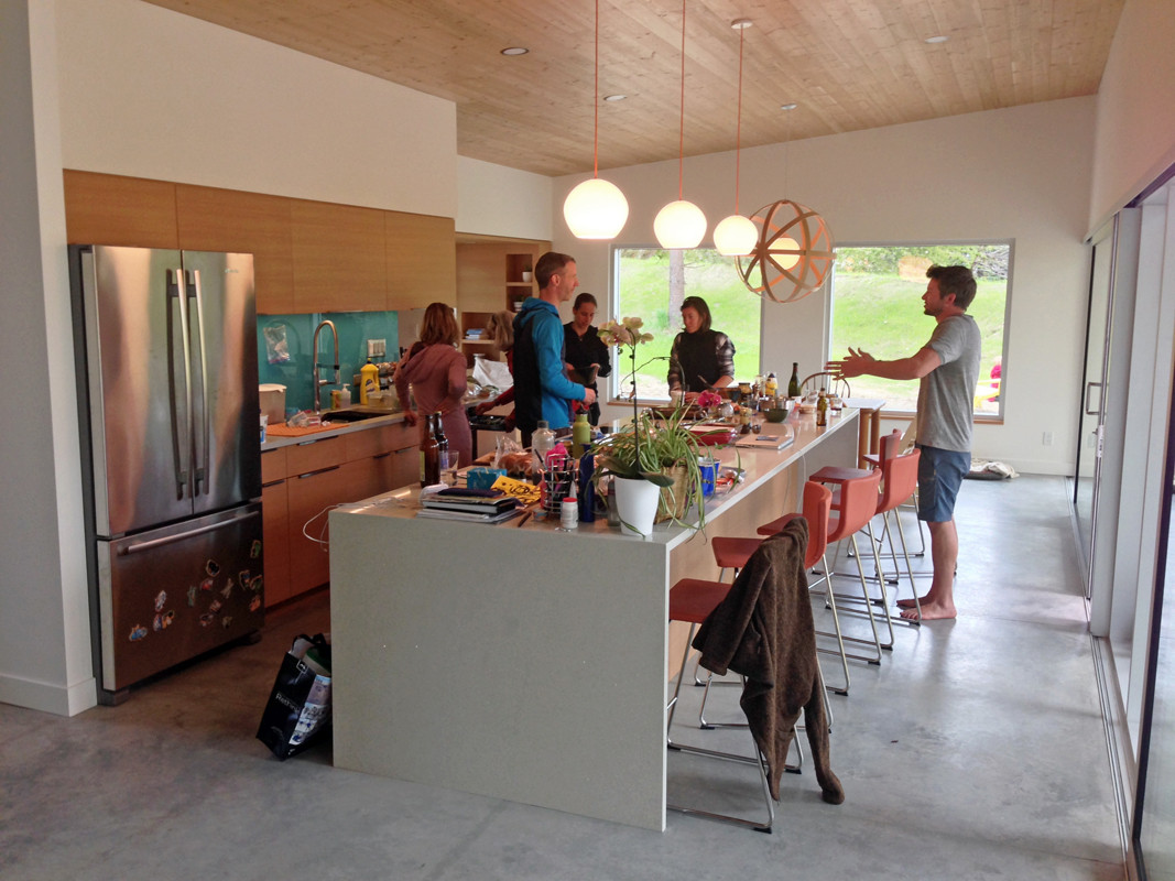 Open concept kitchen/dining space with exposed heated concrete floors.