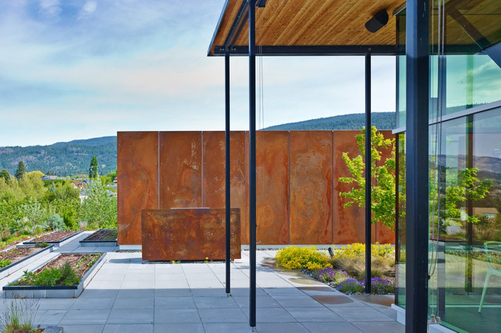Custom fabricated rusted steel cladding panels each with a unique, handmade texture.  image courtesy of Allen + Maurer Architects
