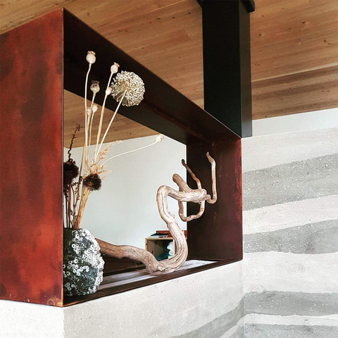Detail of the rammed earth masonry heater.  image courtesy of McDiarmid Construction