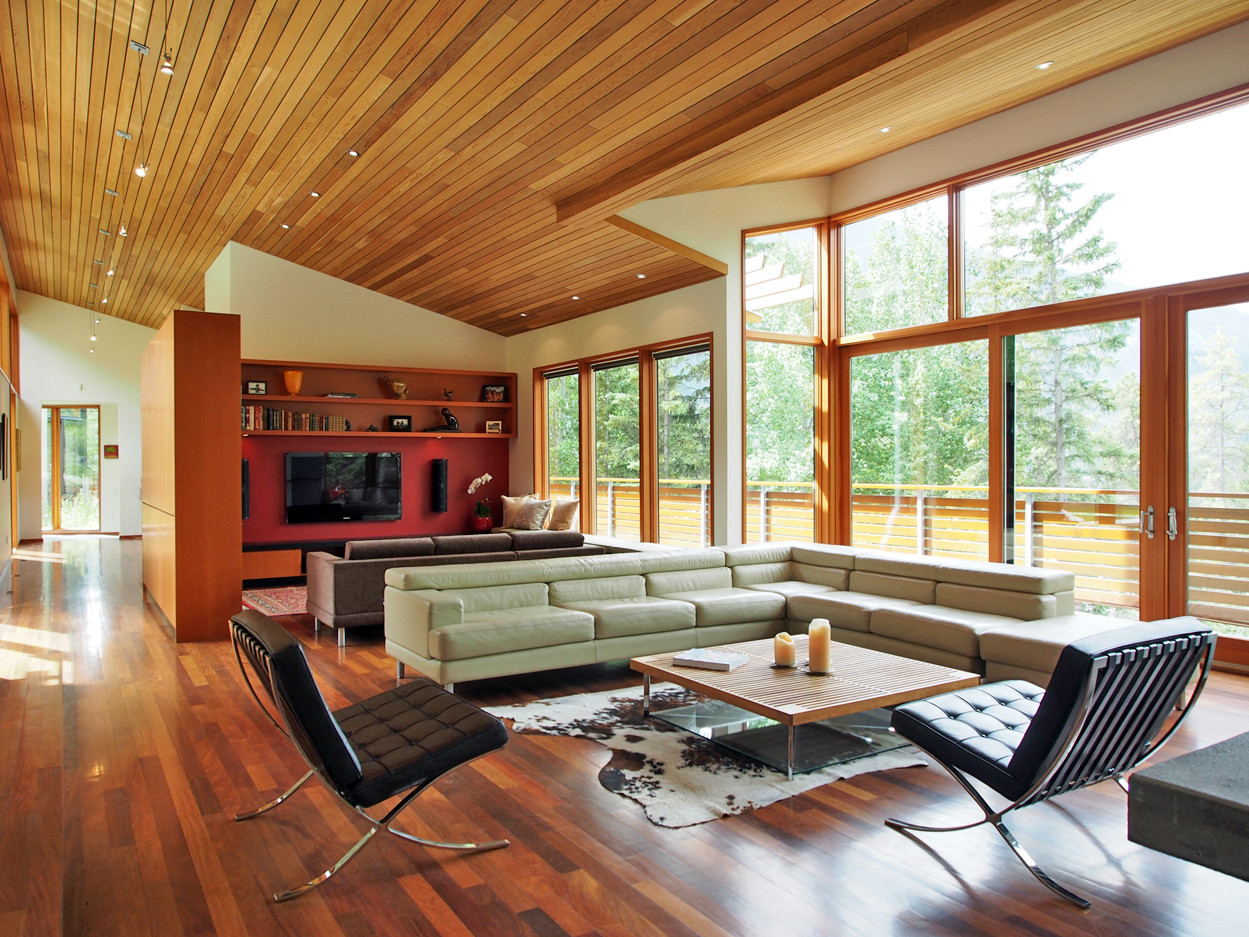 The living room and TV/reading nook open up to views across the Bow Valley.