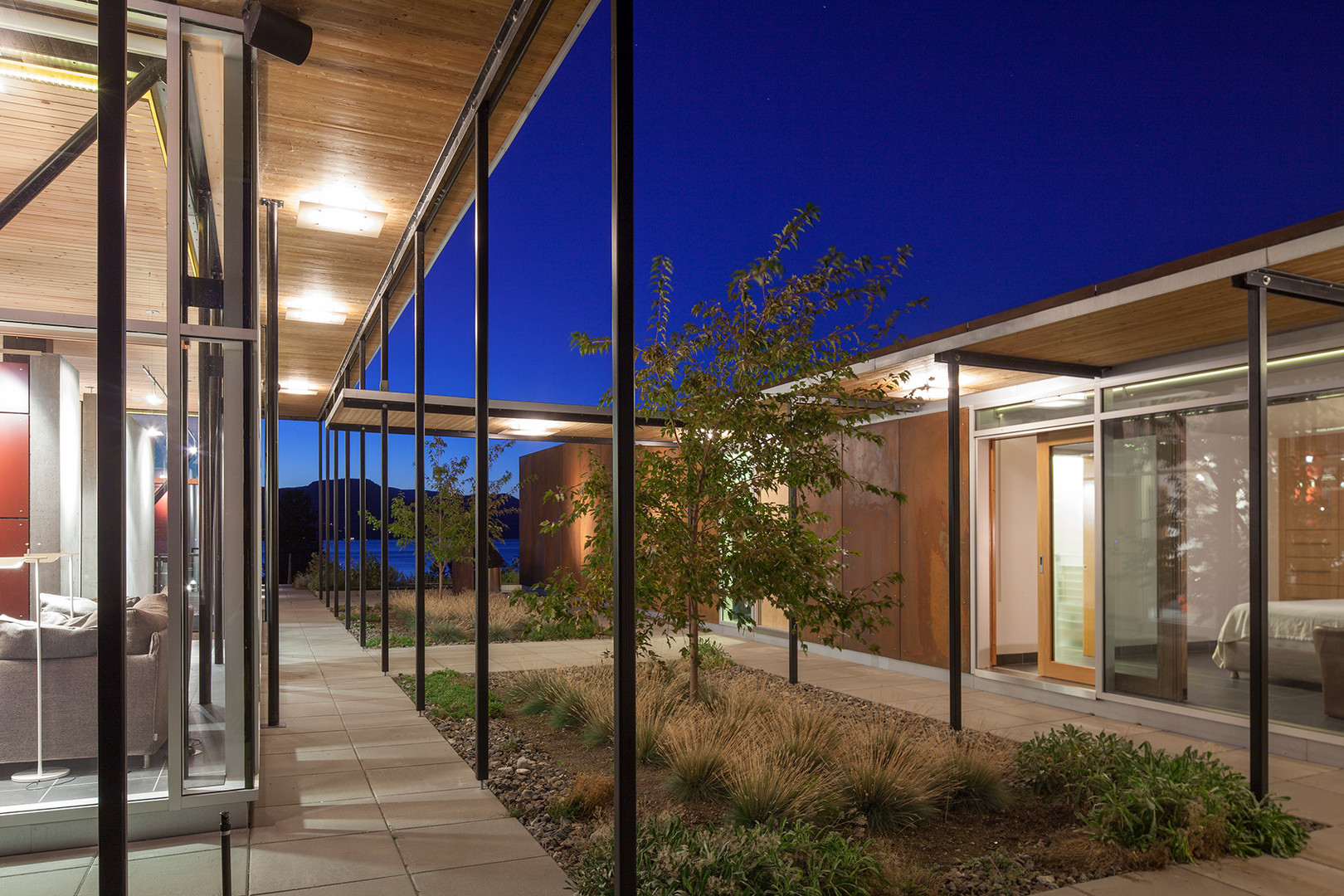 A shaded breezeway between the Glass House and the Earth House.  image courtesy of Allen + Maurer Architects
