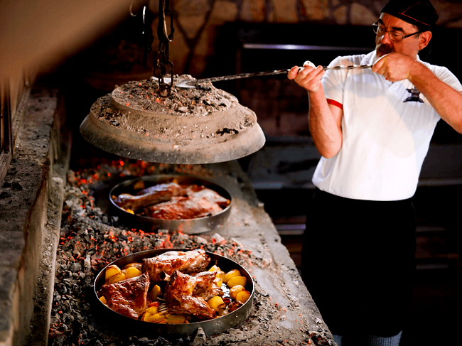 The traditional Montenegrin cooking method of Ispod Saca