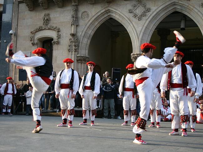 A group of young men dance the traditional 'ezpata-dantza'