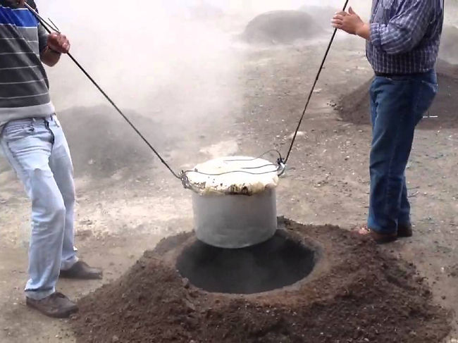 Locals making Cozido das Furnas – a meat stew buried underground and cooked using natural heat
