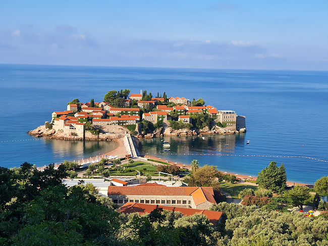 Sveti Stefan, a luxury resort, was an island but is now connected to the mainland by a narrow tombolo