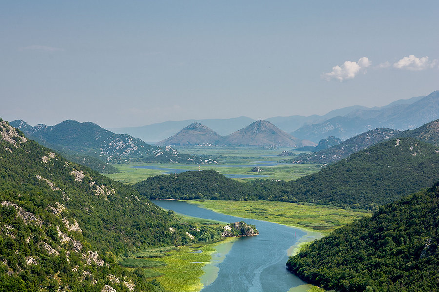 The winding Bojana River connects Lake Skadar with the Adriatic Sea