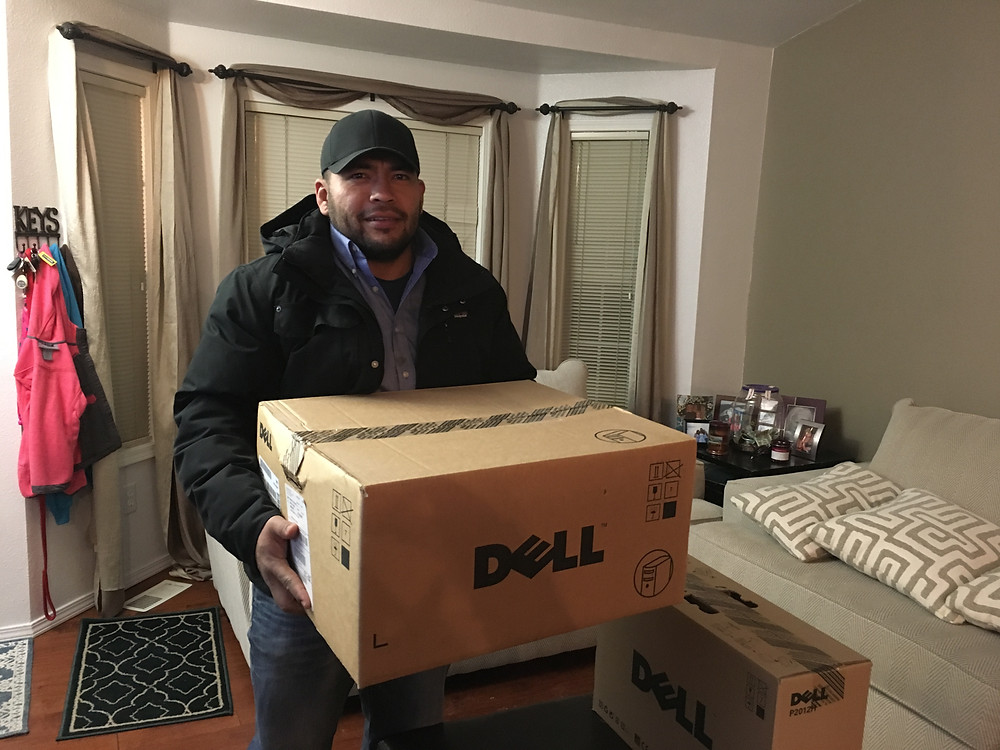 Jorge Hernandez receives his new computer from Limbitless