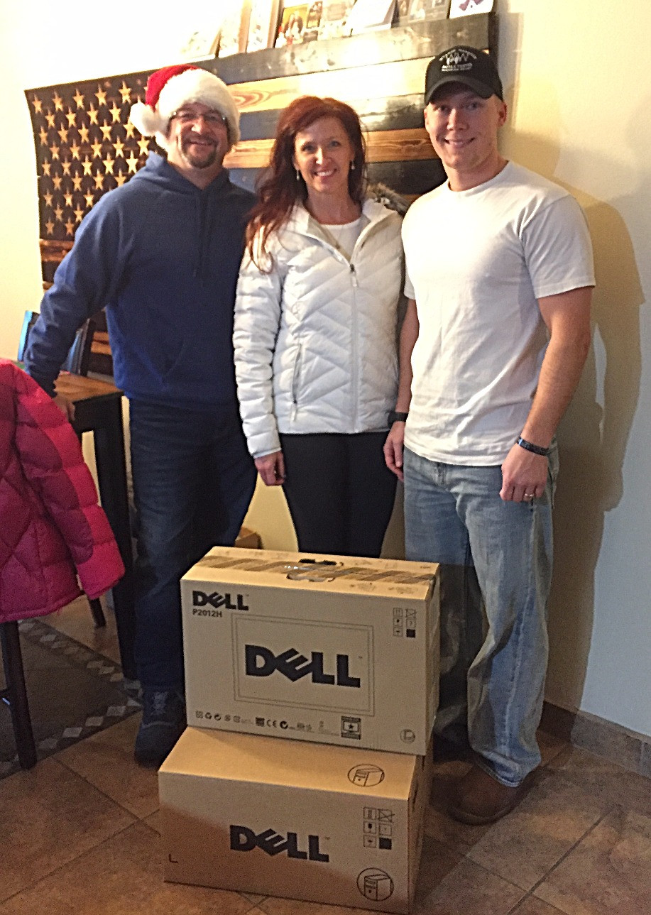 Cory Albertson receiving his new computer from Limbitless.